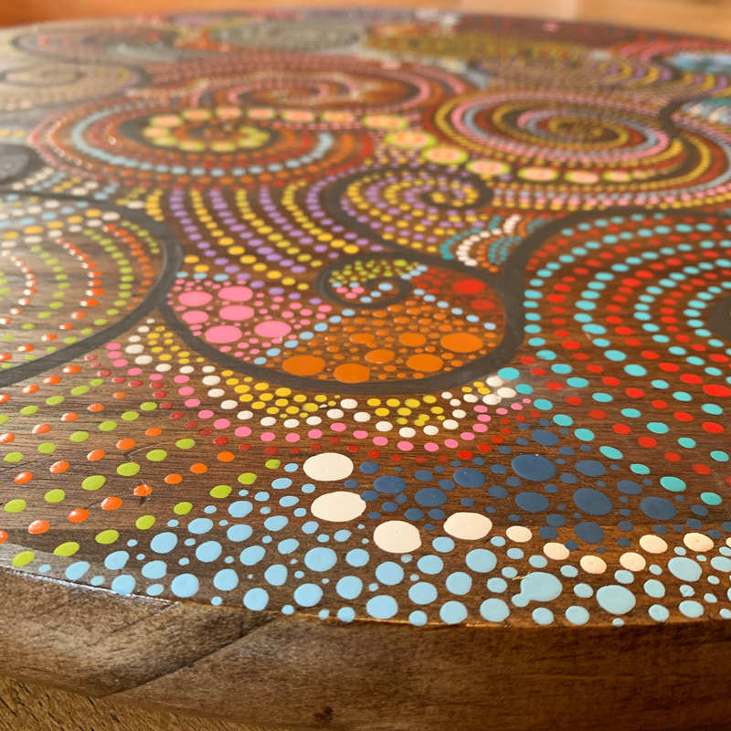 dot art painting on wood
