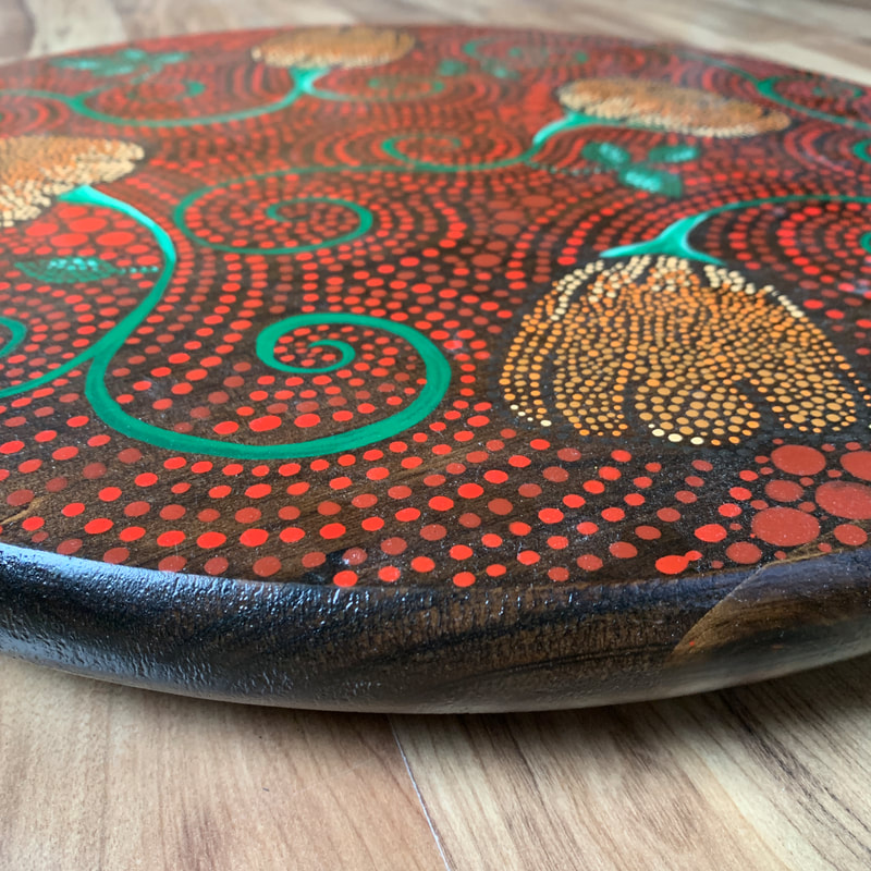 Dot art pumpkins on a wood lazy susan