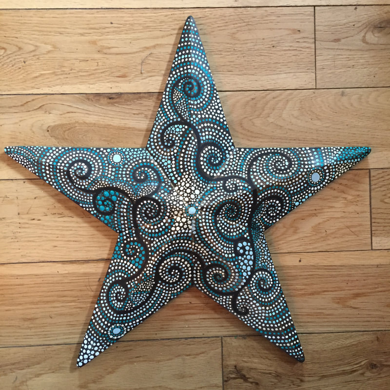 Dot art painting on a wood star